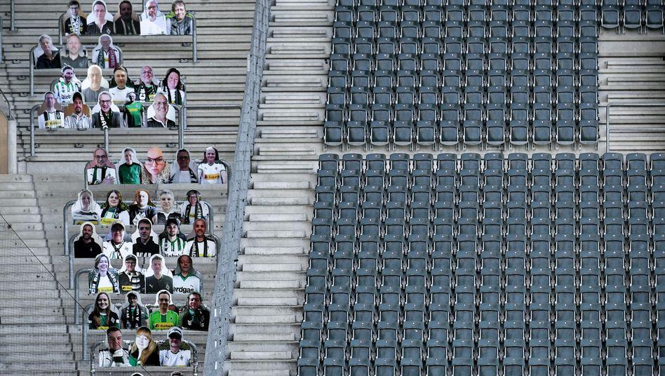 Pappfans beim Geisterspiel: Borussia Mönchengladbach will auch ohne Zuschauer im Stadion Fans auf den Tribünen sehen