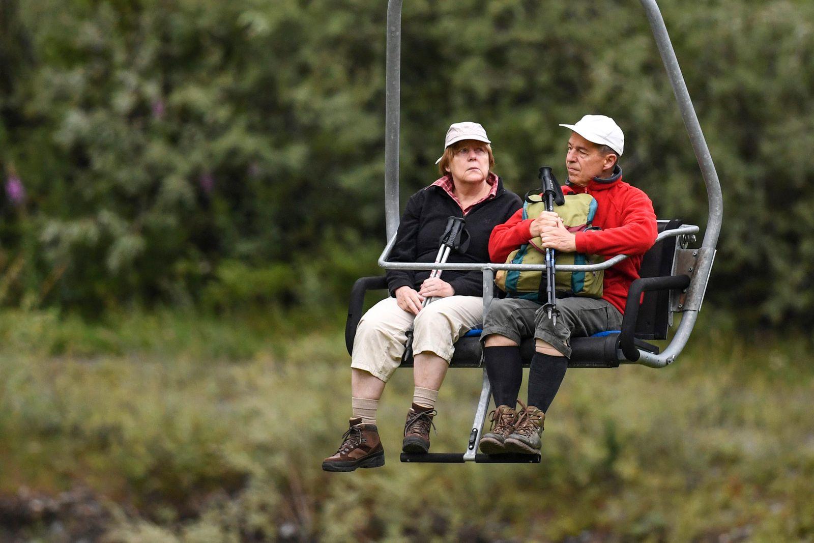 Angela Merkel and Joachim Sauer spotted on a chair li...