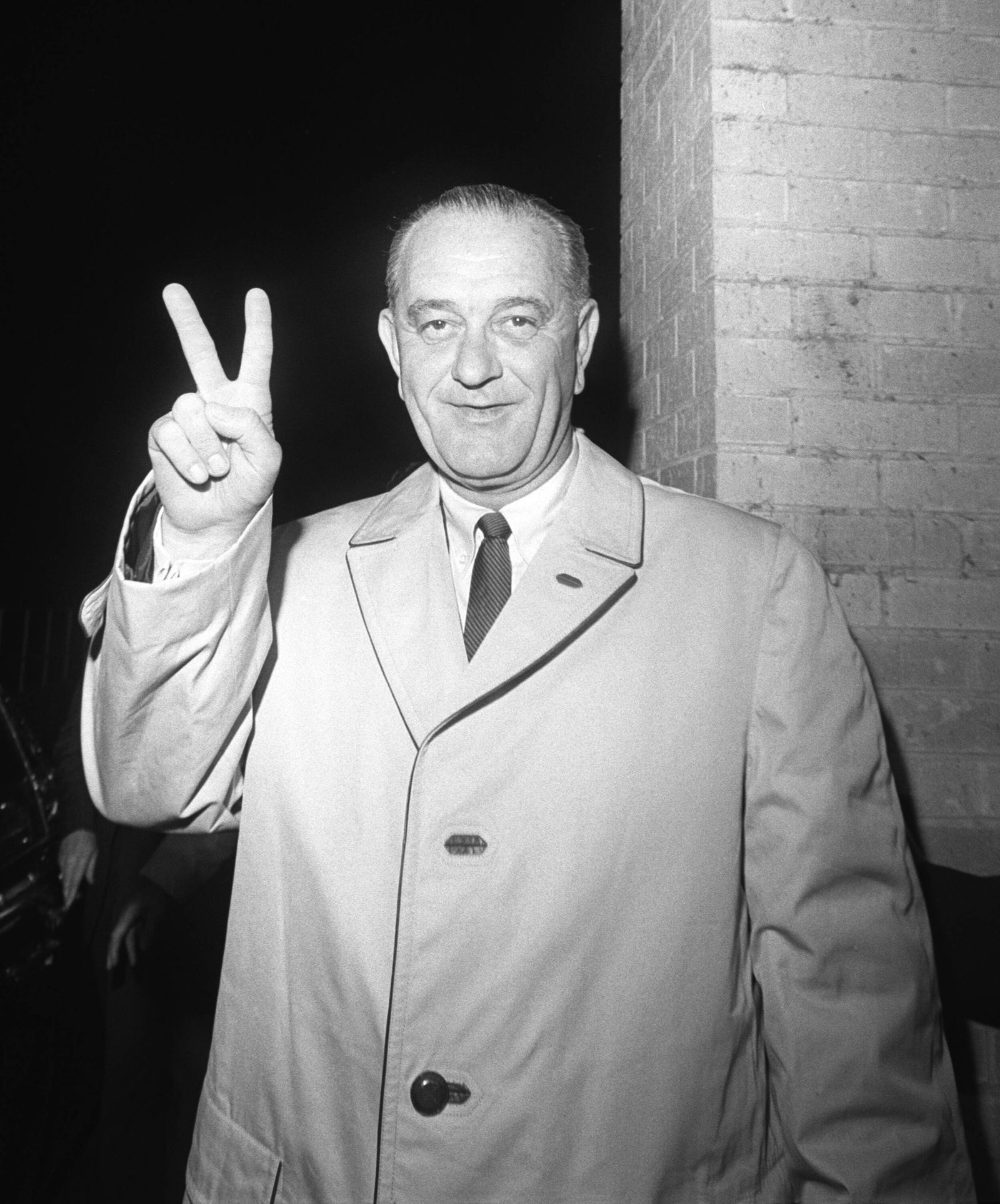 1964 Presidential Election. Lyndon Johnson gives the victory sign at the Driskill Hotel, where he waited to hear the ele
