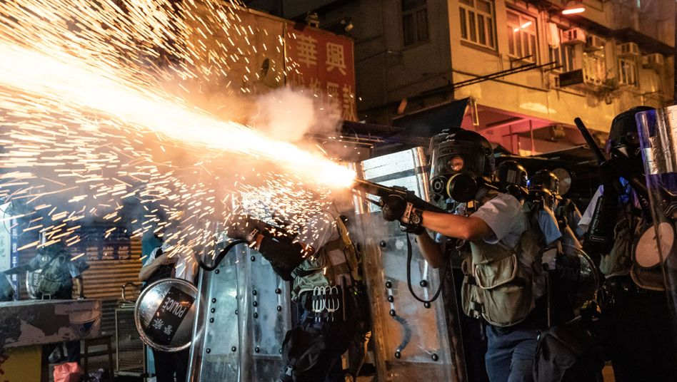 Police in Hong Kong fire tear gas to clear pro-democracy protestors in the city.