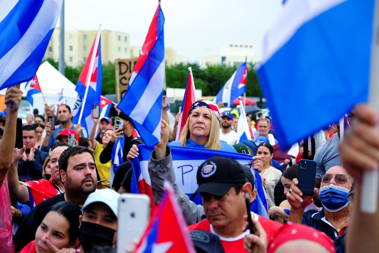 Emigres in the Little Havana neighborhood gather following reports of protests in Cuba against its deteriorating economy, in Miami