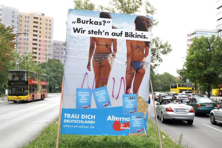 "An AfD sign: ""Burqas? We prefer bikinis."""