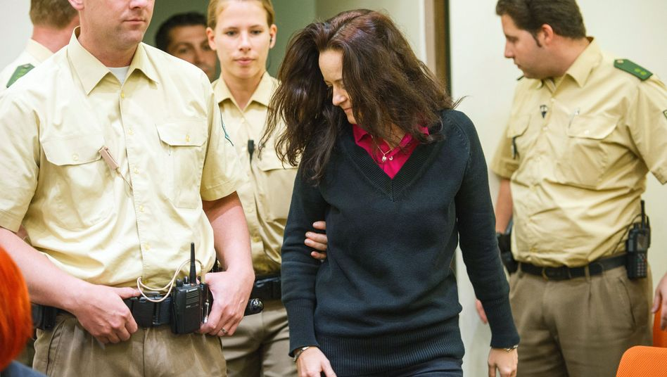 Suspect Beate Zschäpe is escorted by police into a courtroom in Munich on Tuesday.