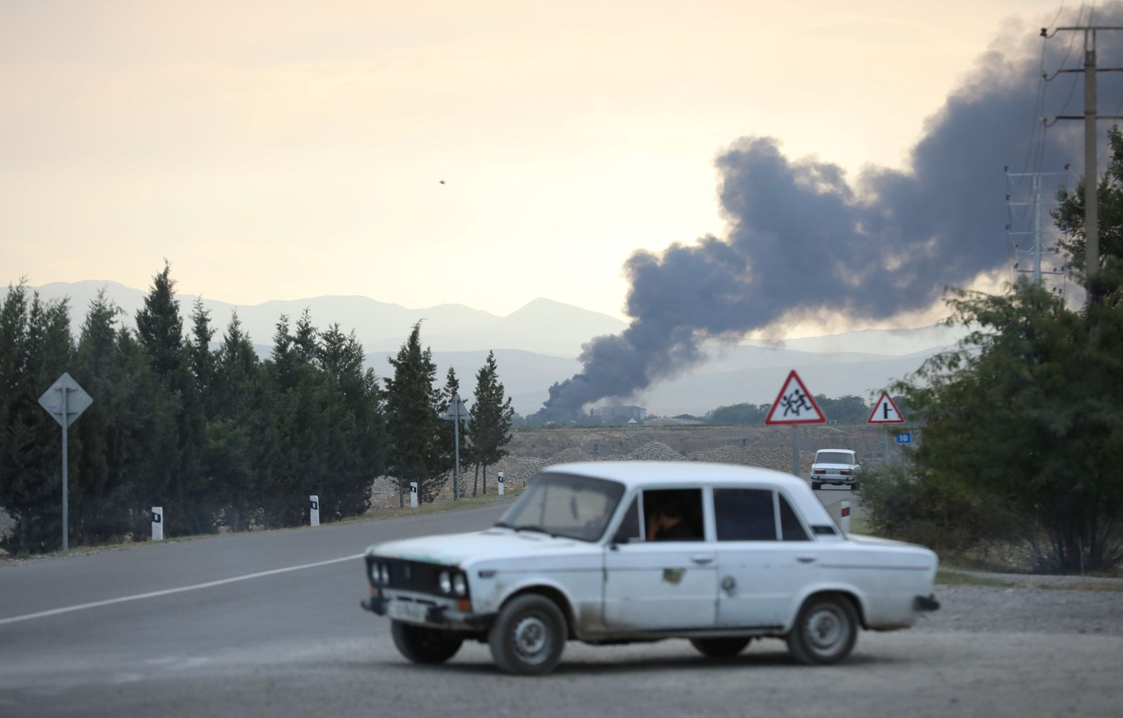 Smoke rises after alleged shelling during a military conflict over the breakaway region of Nagorno-Karabakh, in Terter