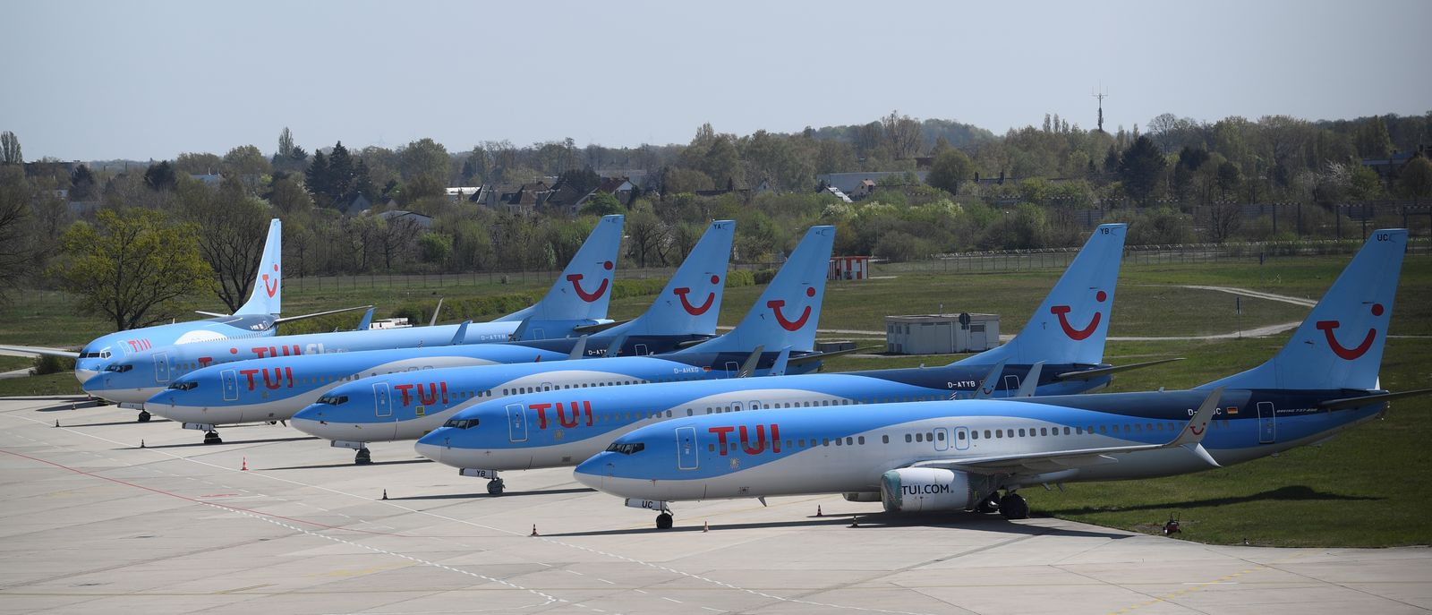 FILE PHOTO: Planes of the German carrier Tui are parked on a closed runway during the spread of the coronavirus disease (COVID-19) at the airport in Hanover,