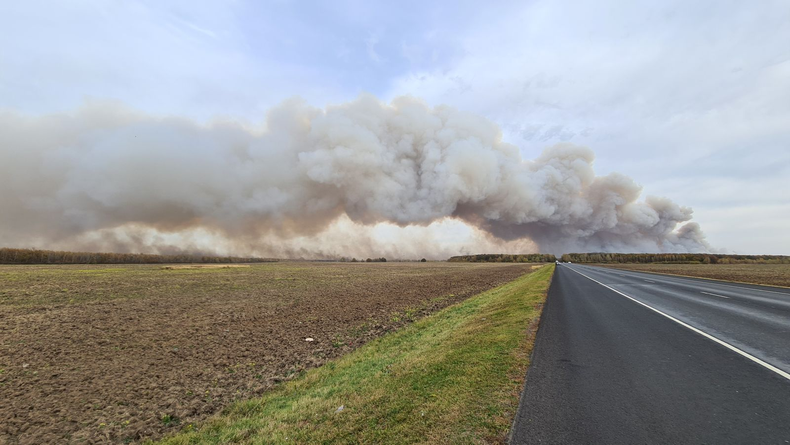 Smoke rises from the site of a fire at an ammunition depot in Ryazan Region