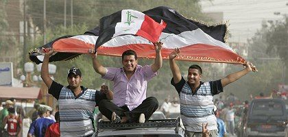 Baghdad residents celebrating their national team's victory over China in World Cup 2010 qualifying. The streets of the nation's capital are slowly becoming safer.