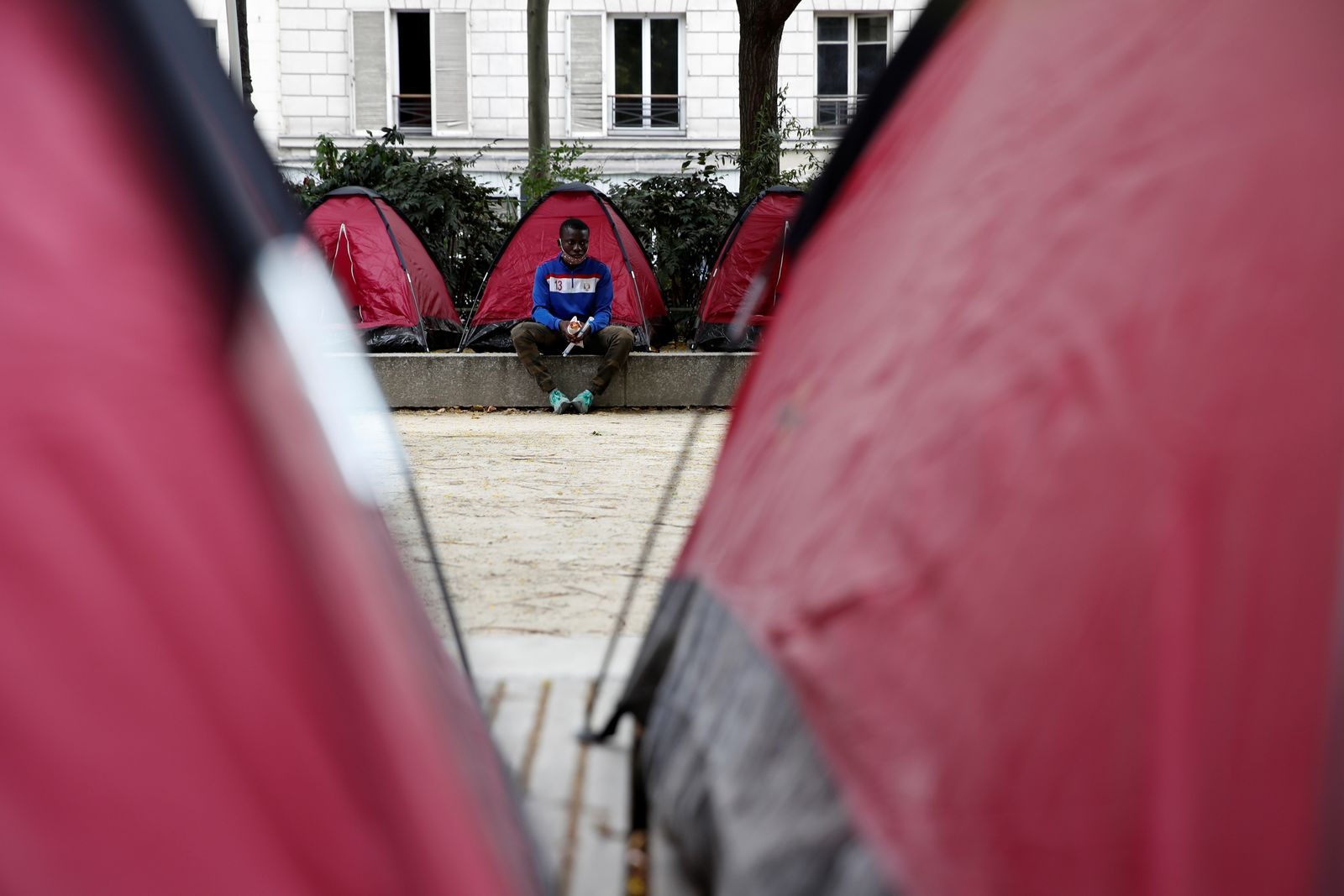Groups set up adolescent migrant camp in Paris to highlight their plight