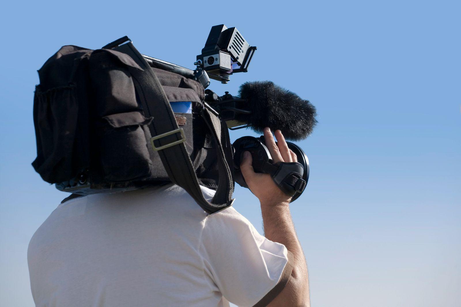 Cameraman at work outdoors