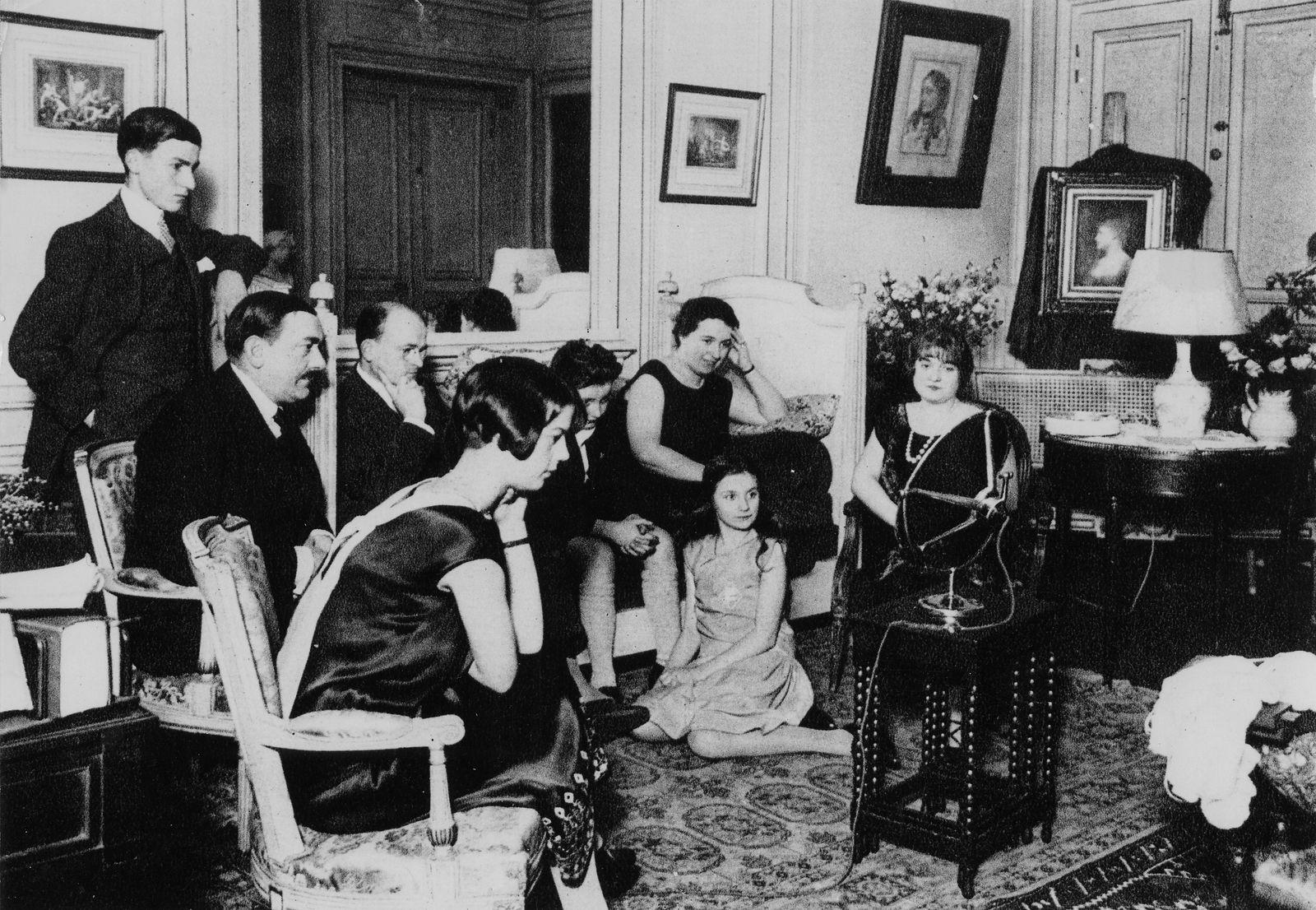 Family listening to the radio
