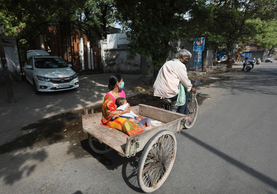 "An Indian mother tries to bring her sick son to the hospital. Public transportation isn't running. The coronavirus has often been referred to as an ""equalizer."" In fact, it has often exacerbated social injustices around the world."