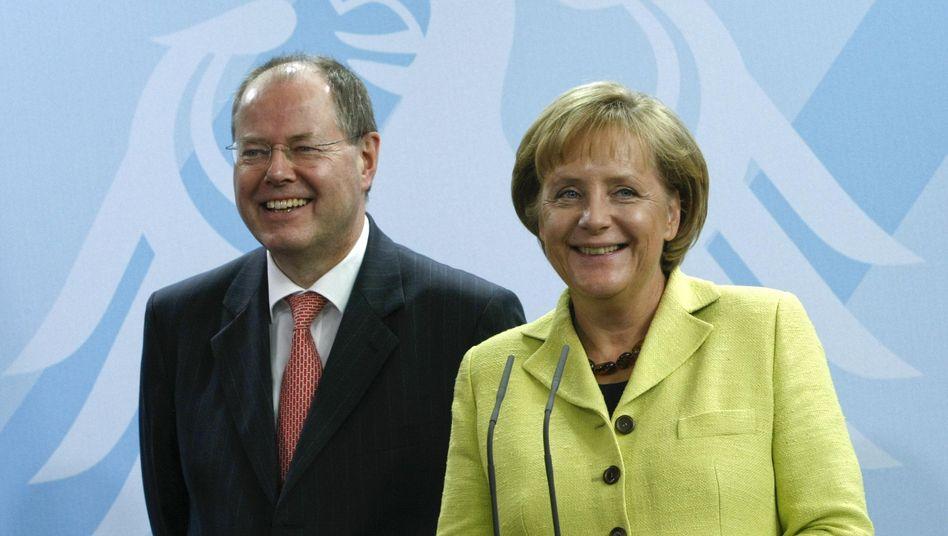 SPD chancellor candidate Peer Steinbrück together with Chancellor Angela Merkel in 2009, when he was finance minister in Merkel's cabinet.