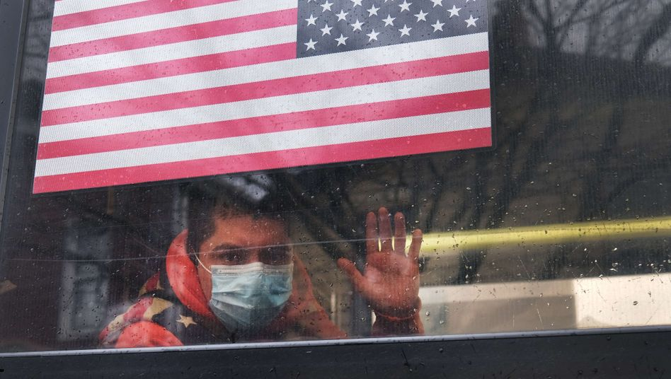 A bus passenger in New York on April 3: A world power in freefall.