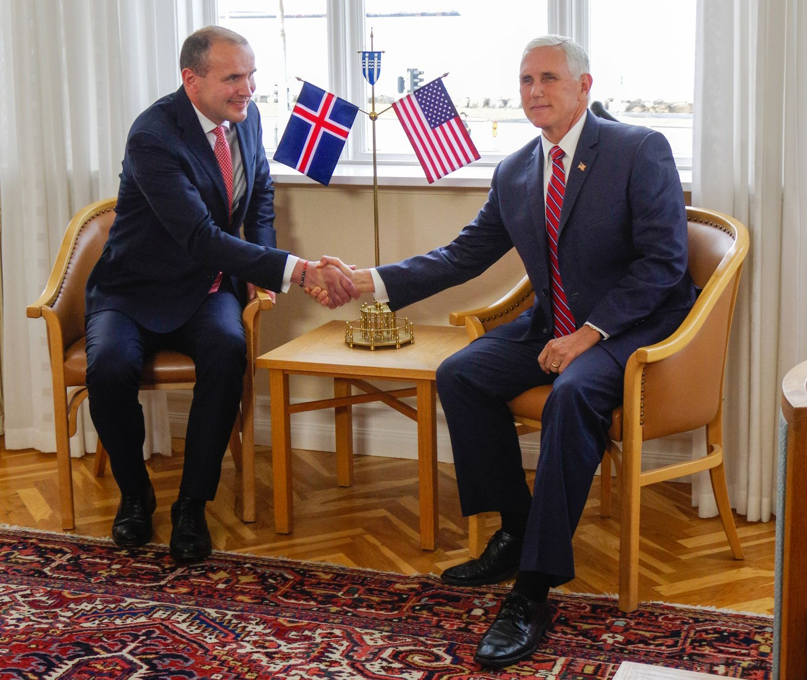 Iceland's President Johannesson shakes hands with U.S. Vice President Pence in Hofdi House in Reykjavik