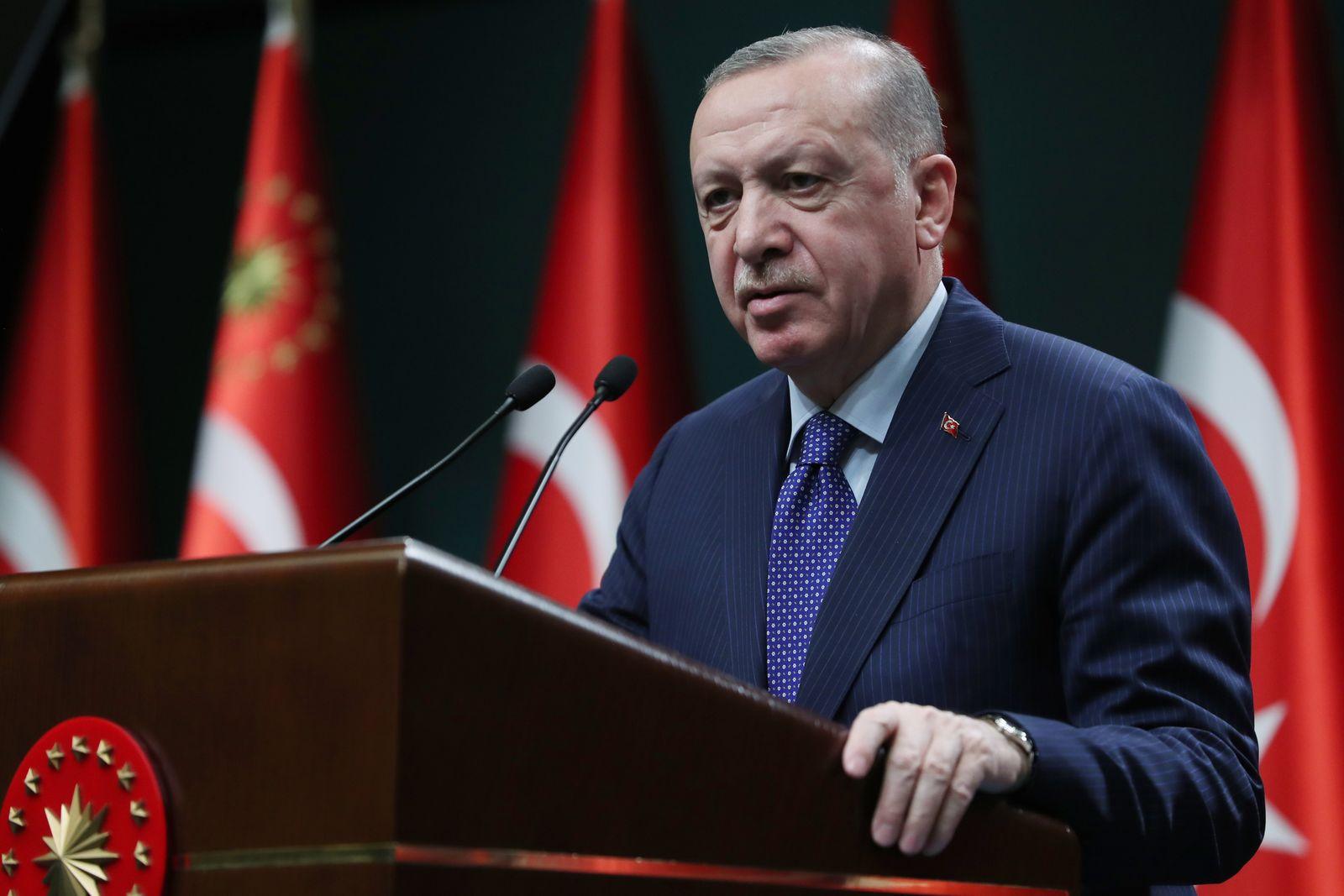 Turkish President Recep Tayyip Erdogan speaks to the media