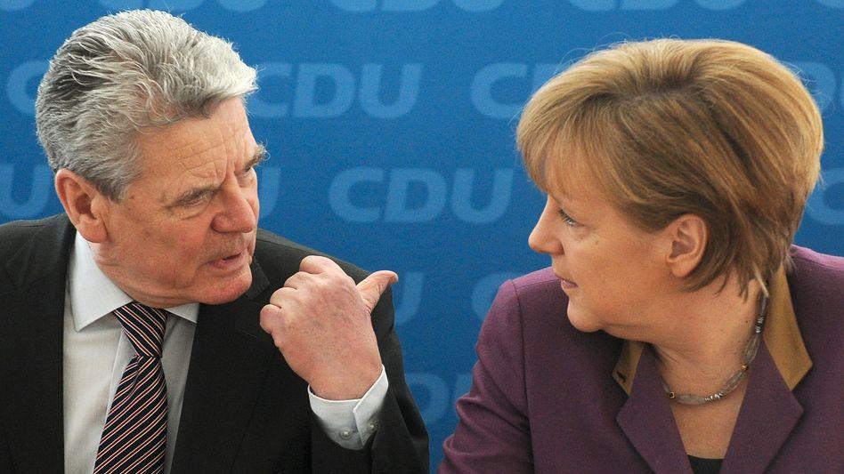 German President Joachim Gauck and Chancellor Angela Merkel.
