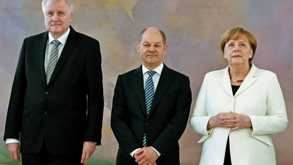 Horst Seehofer, Olaf Scholz, Angela Merkel (März 2018)