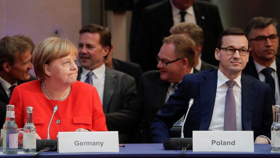 Kanzlerin Angela Merkel und der polnische Premierminister Mateusz Morawiecki
