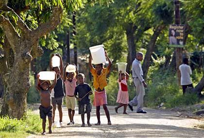 Children carrying water in Durban, South Africa: With better infrastructure, business would be easier in Africa.