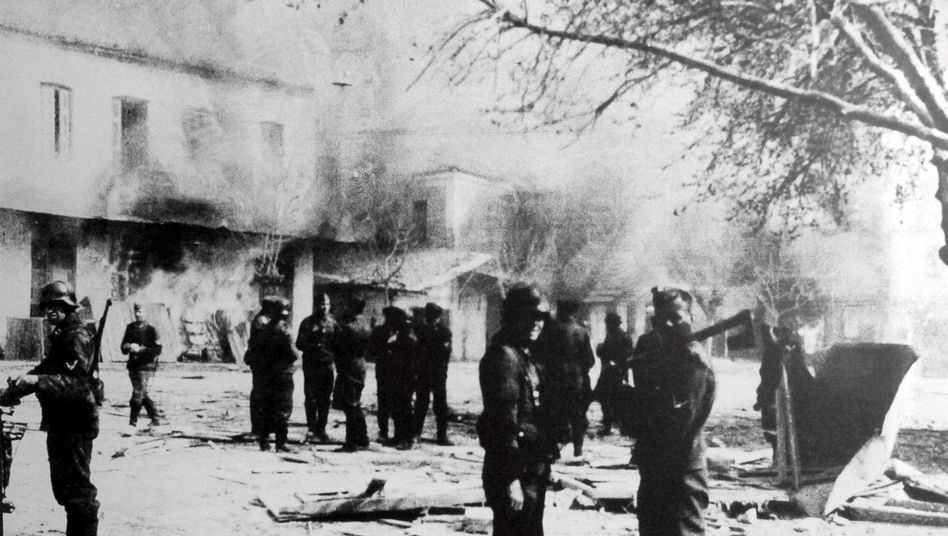 German occupation troops in the ransacked Greek village of Distomo on June 10, 1944, shortly after 218 local residents were executed as part of Nazi reprisals.
