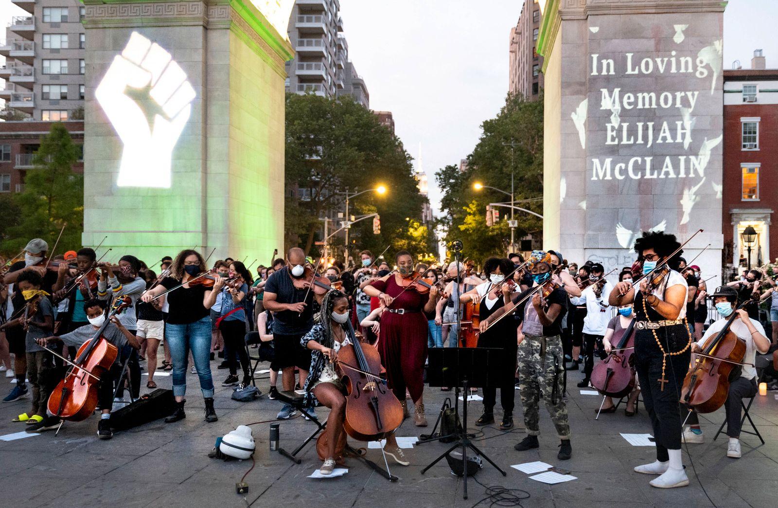 June 29, 2020, New York, New York, U.S: Violinists perform during a Black Lives Matter Vigil for Elijah McClain at Washi