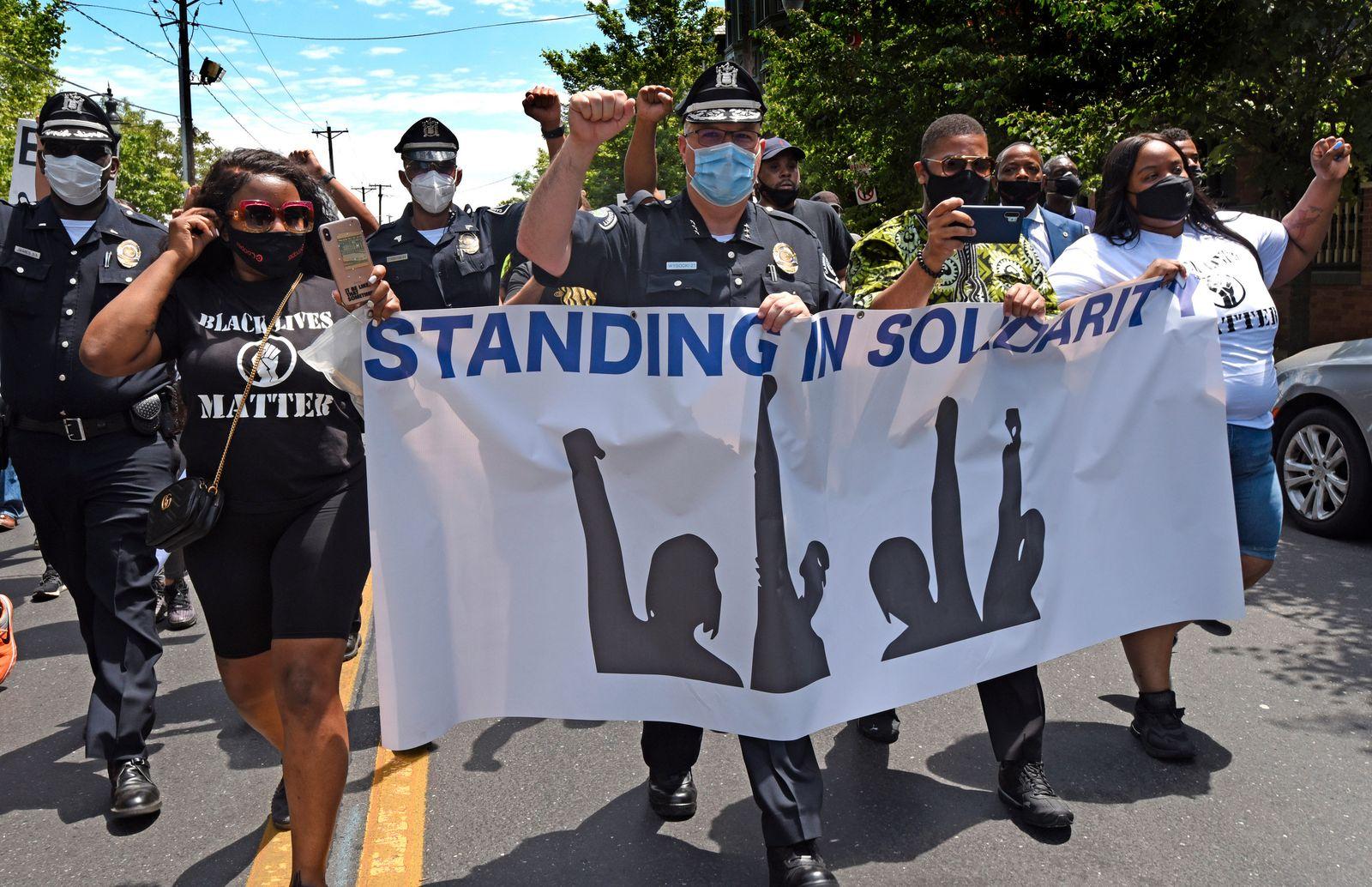 APTOPIX America Protests Police Praise