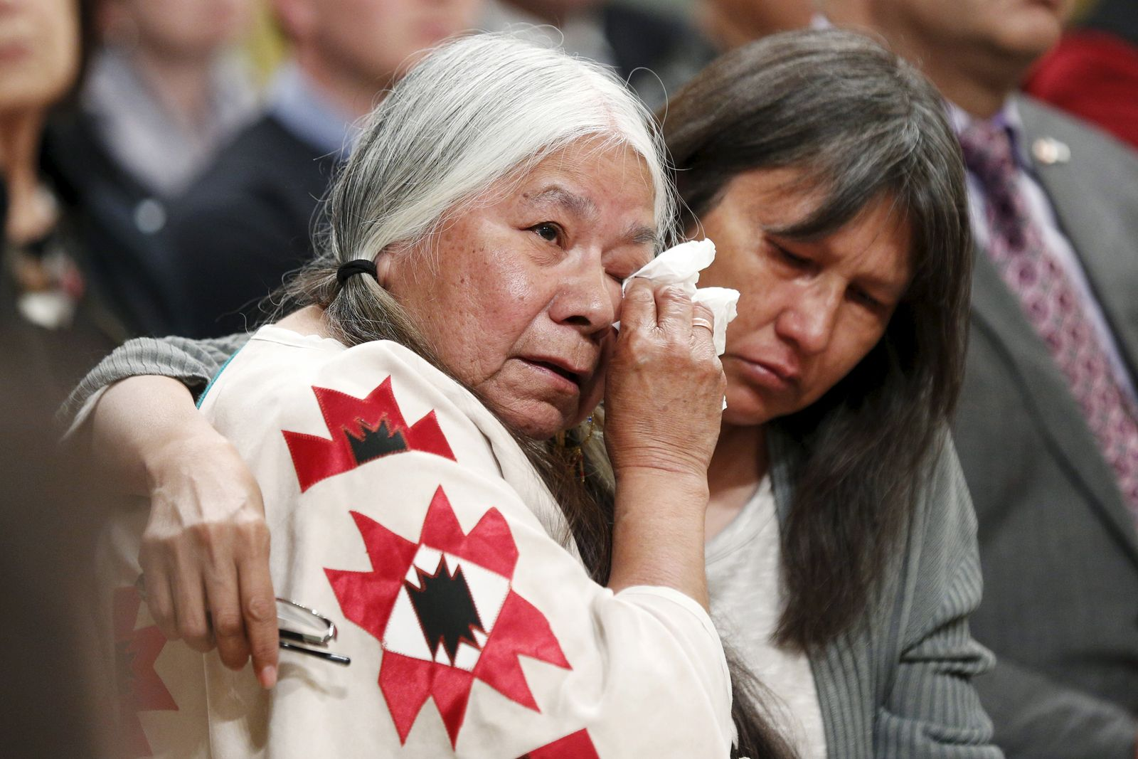 Residential School survivor Lorna Standingready is comforted during the Truth and Reconciliation Commission of Canada closing ceremony at Rideau Hall in Ottawa