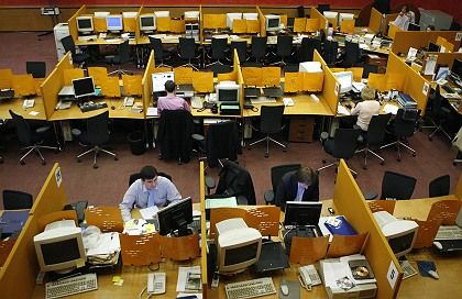 Moscow Interbank Currency Exchange traders are seen during a suspended session in Moscow on Tuesday, Sept. 30, 2008.