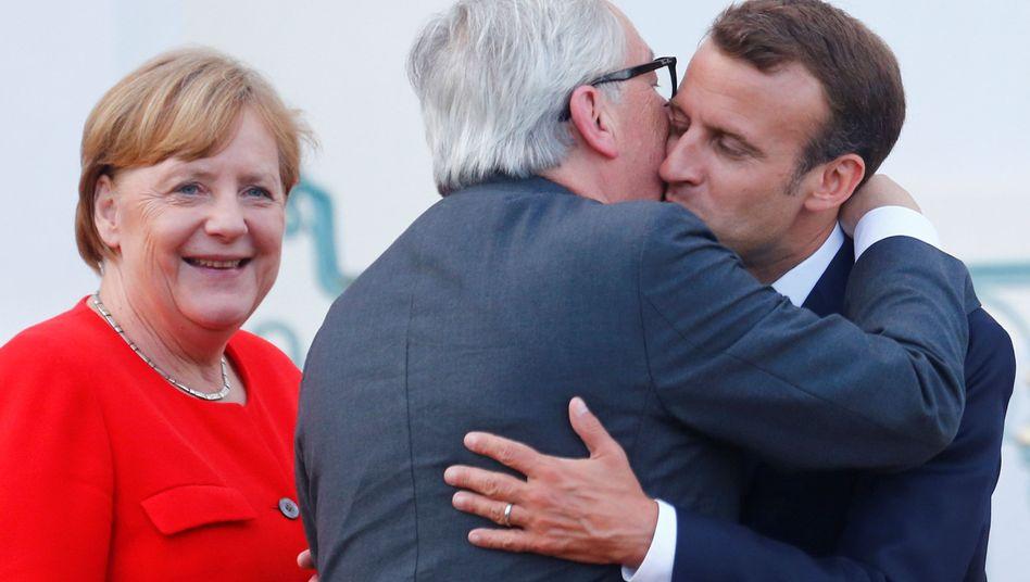 Kanzlerin Merkel, EU-Kommissionschef Juncker, französischer Präsident Macron