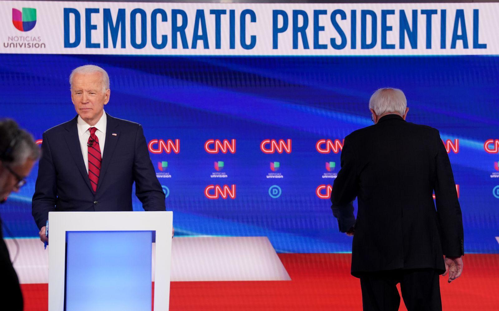 Democratic U.S. presidential candidates Senator Bernie Sanders and former Vice President Joe Biden during break at the 11th Democratic candidates debate of the 2020 U.S. presidential campaign in Washington