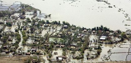An aerial photograph of a flooded village in Myanmar