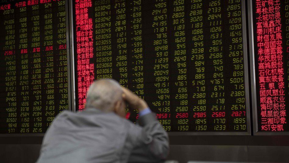 Kurstafel in Peking: In Asien bedeuten grüne Zahlen Verluste