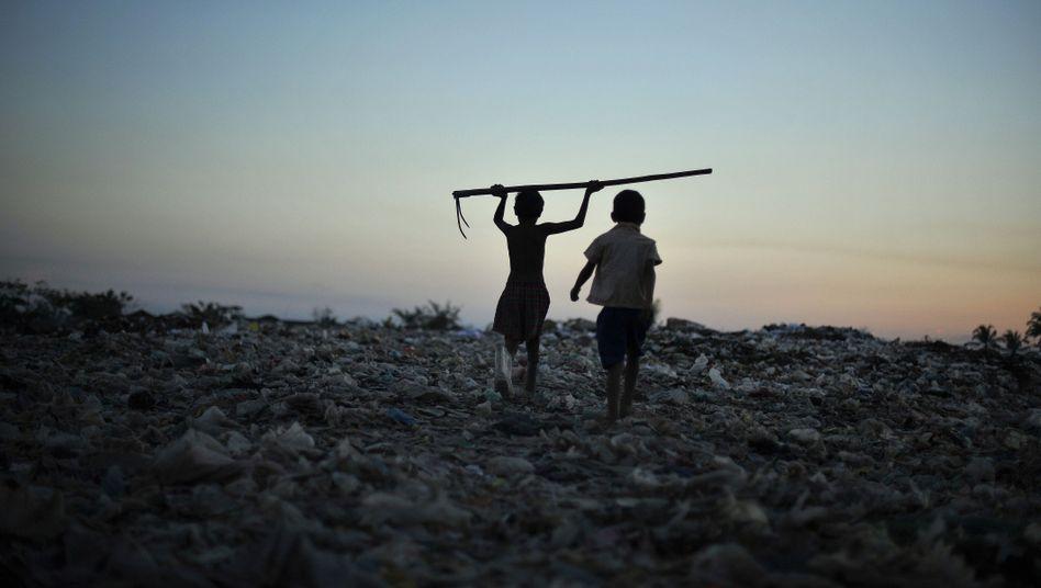 Kinder auf Müllkippe (in Myanmar): Ungleichheit weltweit wächst immer schneller