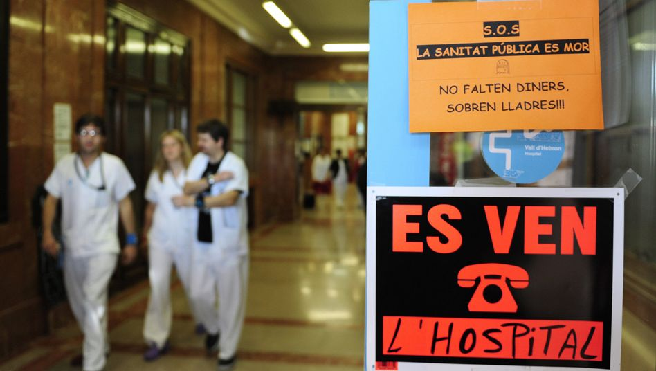 A sign at a clinic in Barcelona reads 'Hospital for sale.'