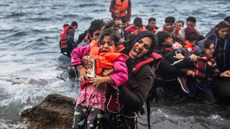 Refugees along the coast of the Greek island Lesbos on Oct. 2, 2015