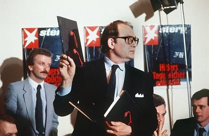 Better days: Heidemann at a news conference on April 25, 1983, holding up one of the diaries.