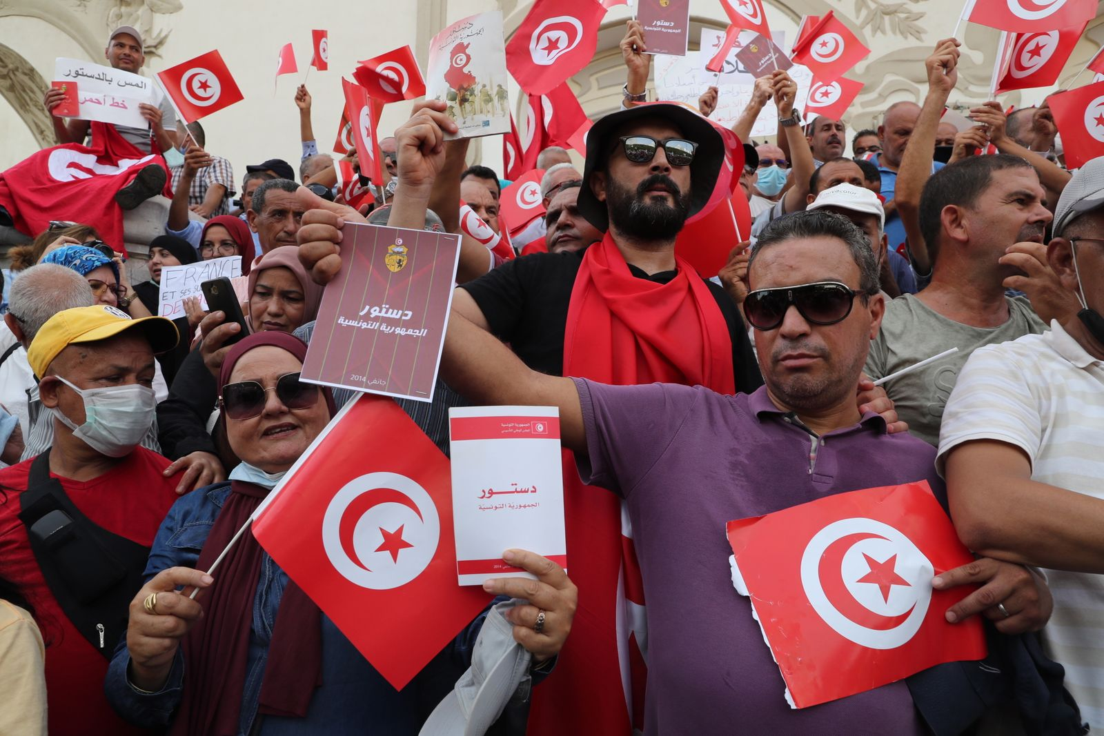 Opponents of Tunisia's President Kais Saied take part in a protest