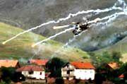 Vaksince unter Beschuss: Schwere Artillerie und Kampfhubschrauber vertrieben die albanischen Rebellen aus dem Dorf