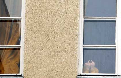 A student gestures out the window at Rütli school in Berlin.