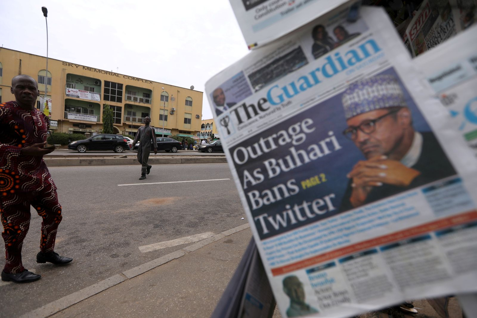 FILE PHOTO: Man looks at newspapers at a newsstand in Abuja