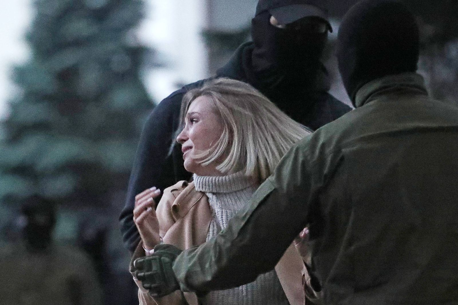 MINSK, BELARUS - SEPTEMBER 8, 2020: Law enforcement officers detain a woman during a march held by opposition activists