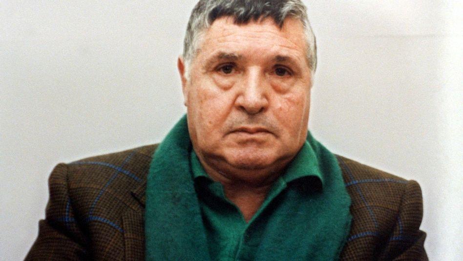 """Mafiaboss Salvatore """"Totò"""" Riina bei seiner Festnahme 1993 in Palermo"""