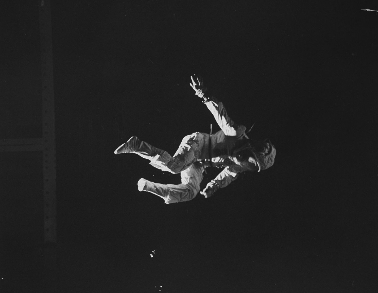 A trampolinist in a space suit imitating