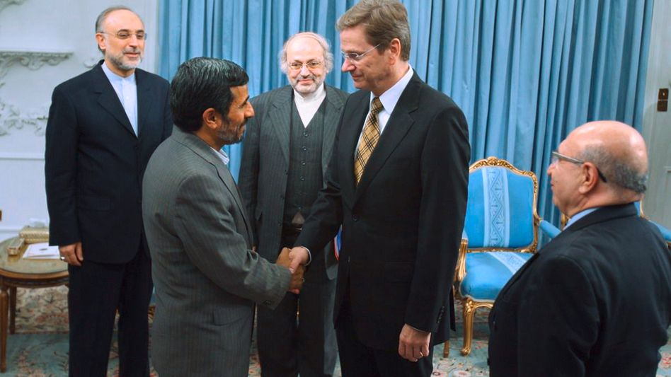 Iranian President Mahmoud Ahmadinejad (L) shakes hands with German Foreign Minister Guido Westerwelle on Feb. 19, 2011.
