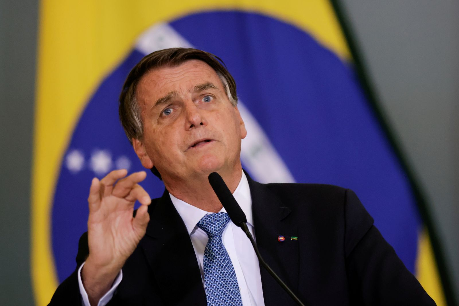 FILE PHOTO: Brazil's President Jair Bolsonaro attends the ceremony for the Modernization of Occupational Health and Safety Regulations, in Brasilia