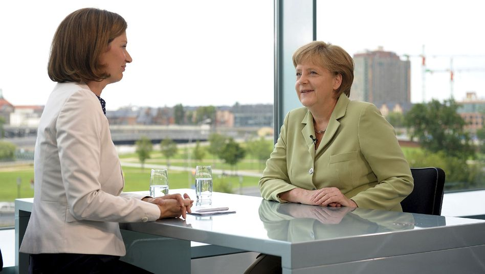 Merkel (R) during her interview with ZDF journalist Bettina Schausen on Sunday.