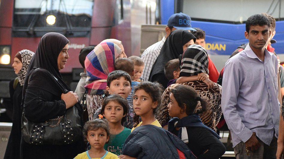 Syrische Flüchtlinge am Hauptbahnhof in München
