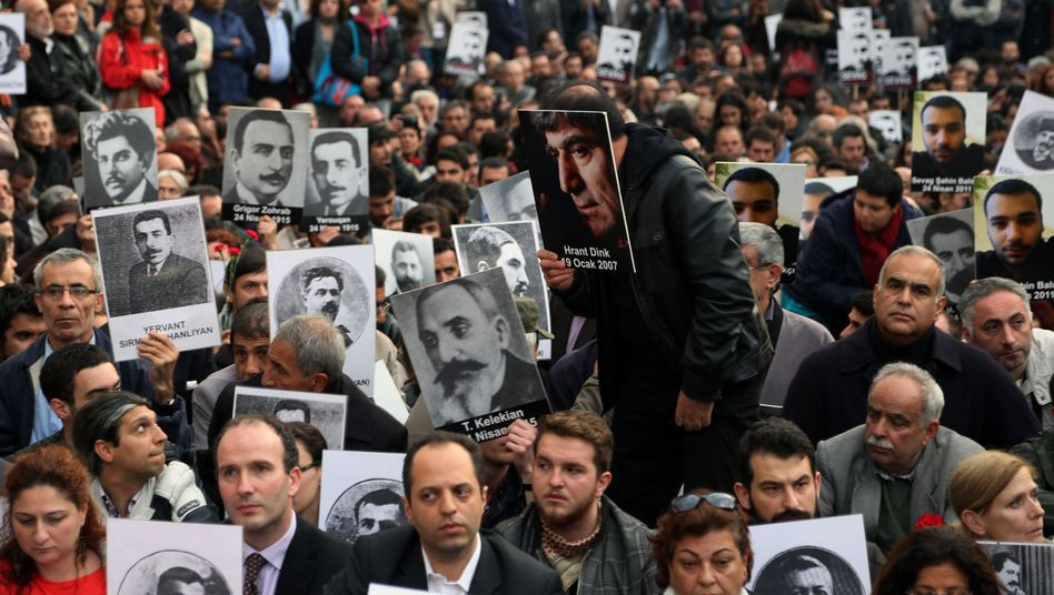 Turkish and Armenian activists gather to protest the deaths of Armenians on the 99th anniversary of the mass killings.