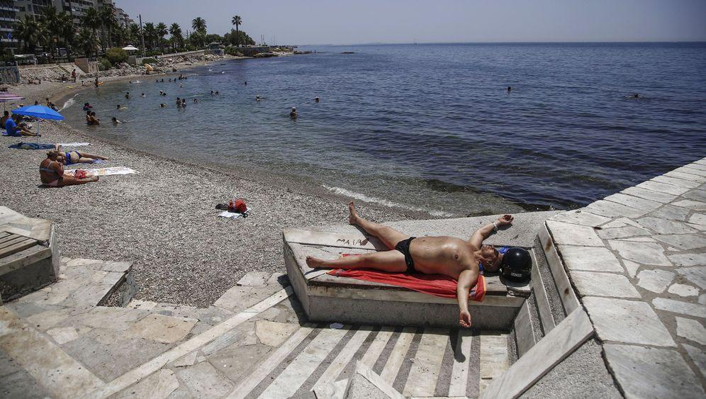 Höllenhitze in Griechenland: Schwitzen im Sonnenuntergang