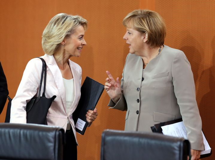 Merkel (right) with her party deputy and Labor Minister Ursula von der Leyen
